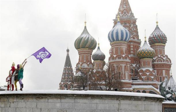 Members of the Russian radical feminist group 'Pussy Riot' stage a protest performance in Red Square in Moscow