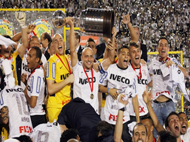 Players of Brazil's Corinthians celebrate with the Copa Libertadores trophy in Sao Paulo