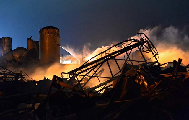 Remains of a fertilizer plant and other buildings and vehicles