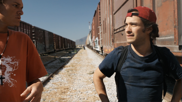 Gael Garcia Bernal prepares to board the train 'La Bestia' with other migrants - February 2011