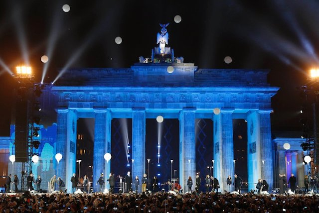 Balloons from installation Border of Light are released in front Brandenburg Gate in Berlin