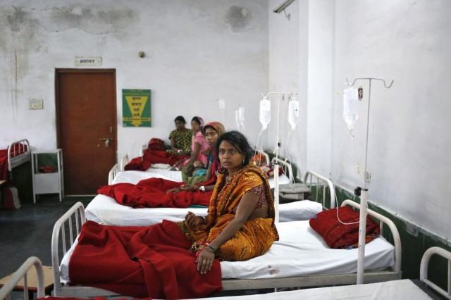 """Women, who underwent a sterilization surgery at a government mass sterilisation """"camp"""", lie in hospital beds for treatment at CIMS hospital in Bilaspur"""