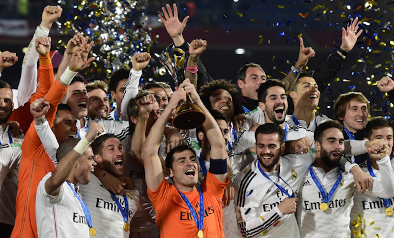 Real Madrid's players celebrate with the trophy after winning the FIF