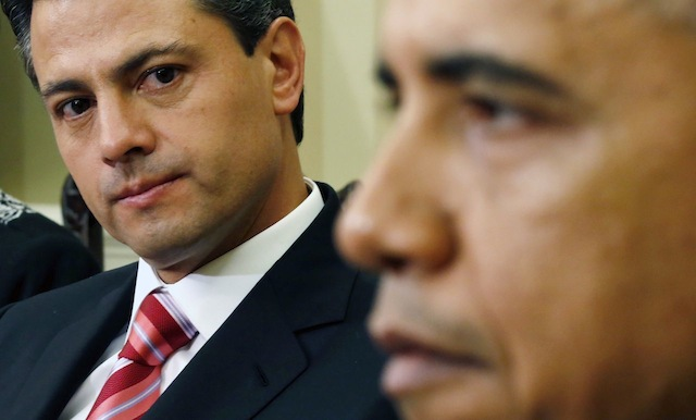President-elect Enrique Pena Nieto of Mexico looks at U.S. President Barack Obama during their meeting at the Oval Office of the White House in Washington