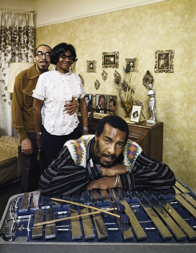 Folk singer Richie Havens leaning on xylophone w. parents (L-R): Richard and Mildred in bkgrd.