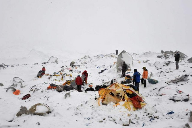 In this photograph taken on April 25, 2015, rescuers look for survivors after an avalanche that flattened parts of Everest Base Camp.   Rescuers in Nepal are searching frantically for survivors of a huge quake on April 25, that killed nearly 2,000, digging through rubble in the devastated capital Kathmandu and airlifting victims of an avalanche at Everest base camp.   AFP PHOTO/Roberto SCHMIDTROBERTO SCHMIDT/AFP/Getty Images