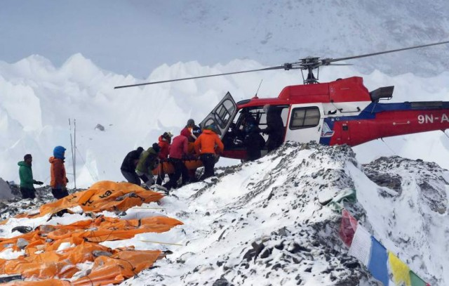 TOPSHOTS An injured person is loaded onto a rescue helicopter at Everest Base Camp on April 26, 2015, a day after an avalanche triggered by an earthquake devastated the camp. Rescuers in Nepal are searching frantically for survivors of a huge quake on April 25, that killed nearly 2,000, digging through rubble in the devastated capital Kathmandu and airlifting victims of an avalanche at Everest base Camp.  The bodies of those who perished lie under orange tents.  AFP PHOTO/ROBERTO SCHMIDTROBERTO SCHMIDT/AFP/Getty Images