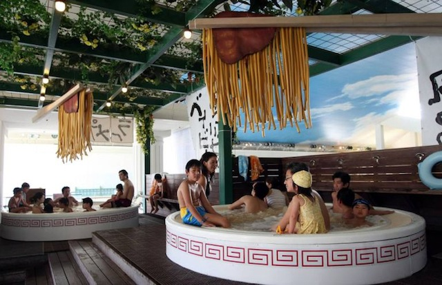"HAKONE, JAPAN - APRIL 19:  Visitors enjoy the ""soup noodle spa"" at the Hakone Yunessun Spa on April 19, 2008 in Hakone, Kanagawa Prefecture, Japan. The spa, which has previously offered customers spa baths filled with chocolate and Beaujolais wine, is celebrating their 10 millionth visitor since their opening in 2001 with the noodle spa until June 30.  (Photo by Junko Kimura/Getty Images)"