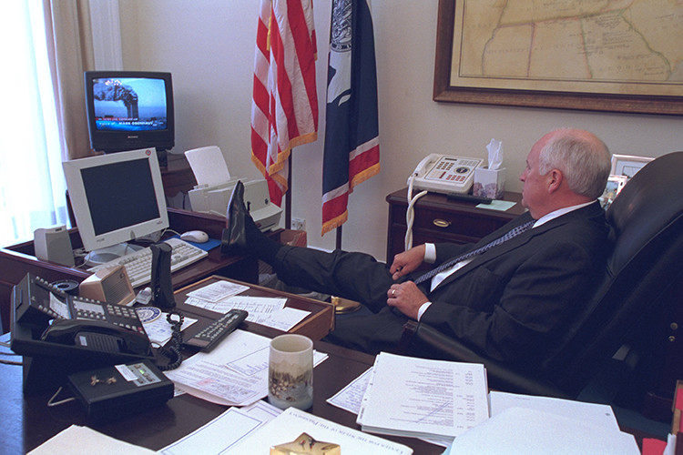 U.S. Vice President Dick Cheney watches television reports in Washington in the hours following the September 11, 2001 attacks in this U.S. National Archives handout photo obtained by Reuters July 24, 2015. REUTERS/U.S. National Archives/Handout via Reuters (MILITARY POLITICS DISASTER) THIS IMAGE HAS BEEN SUPPLIED BY A THIRD PARTY. IT IS DISTRIBUTED, EXACTLY AS RECEIVED BY REUTERS, AS A SERVICE TO CLIENTS. FOR EDITORIAL USE ONLY. NOT FOR SALE FOR MARKETING OR ADVERTISING CAMPAIGNS - RTX1LQAZ