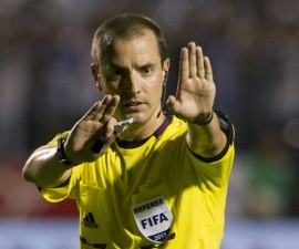 FILE - In this Tuesday Sept. 10, 2013 file photo, referee Mark Geiger signals a call at a 2014 World Cup qualifier soccer match between Honduras and Panama in Tegucigalpa, Honduras. Mark Geiger aims to become the first American referee to advance from the group stage in the World Cup in Brazil. (AP Photo/Moises Castillo, File) ORG XMIT: LON107