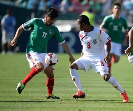 Panama's Marcos Sanchez (R) and Mexico's Rafael Marquez (L) battle for control during Mexico vs Panama 2013 CONCACAF Gold Cup Opener, July 7, 2013 at the Rose Bowl in Pasadena, California.  Panama defeated Mexico 2-1.  AFP PHOTO / ROBYN BECK        (Photo credit should read ROBYN BECK/AFP/Getty Images)