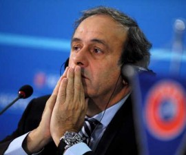 UEFA president Michel Platini gestures during a news conference after the UEFA executive committee meeting in Sofia on March 28, 2013. UEFA reiterated its zero-tolerance policy on racism at a meeting in Sofia, encouraging referees to halt matches if need be and encouraging teams to denounce racism among fellow players and fans.  AFP PHOTO / NIKOLAY DOYCHINOV