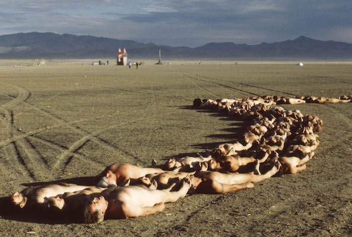 Mandatory Credit: Photo by Neale Haynes/REX (432916a) NAKED REVELLERS AT THE 'BURNING MAN' FESTIVAL 'Burning Man' Festival, Nevada, America - 2003