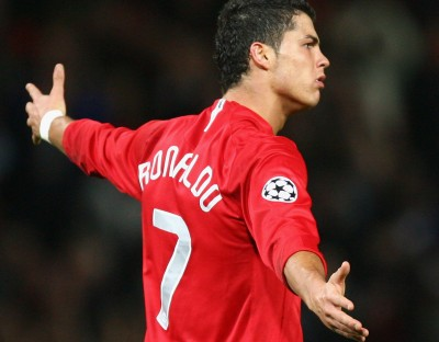 MANCHESTER, UNITED KINGDOM - NOVEMBER 07: Cristiano Ronaldo of Manchester United celebrates scoring his team's fourth goal during the UEFA Champions League Group F match between Manchester United and Dynamo Kyiv at Old Trafford on November 7, 2007 in Manchester, England. (Photo by Alex Livesey/Getty Images)
