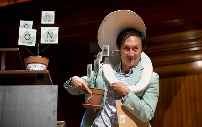 David Hu, from Georgia Institute of Technology, walks away with his team's Ig Nobel Prize in Physics at the 25th First Annual Ig Nobel Prizes awards ceremony at Harvard University in Cambridge