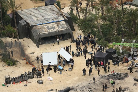 EXCLUSIVE: A burnt out ship and dead Storm Troopers can be seen during filming of Star Wars Rogue One.