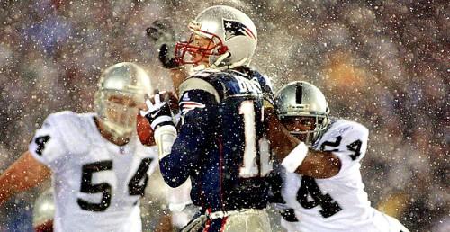 New England Patriots quarterback Tom Brady (C) ta