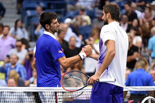September 11, 2015 - Novak Djokovic greets Marin Cilic after a men's singles semifinals match during the 2015 US Open at the USTA Billie Jean King National Tennis Center in Flushing, NY. (USTA/Garrett Ellwood)