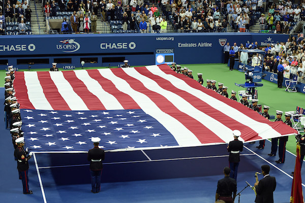 September 13, 2015 - United States Marines present the American flag prior to the men's singles final match between Novak Djokovic (not pictured) and Roger Federer (not pictured) during the 2015 US Open at the USTA Billie Jean King National Tennis Center in Flushing, NY. (USTA/Pete Staples)