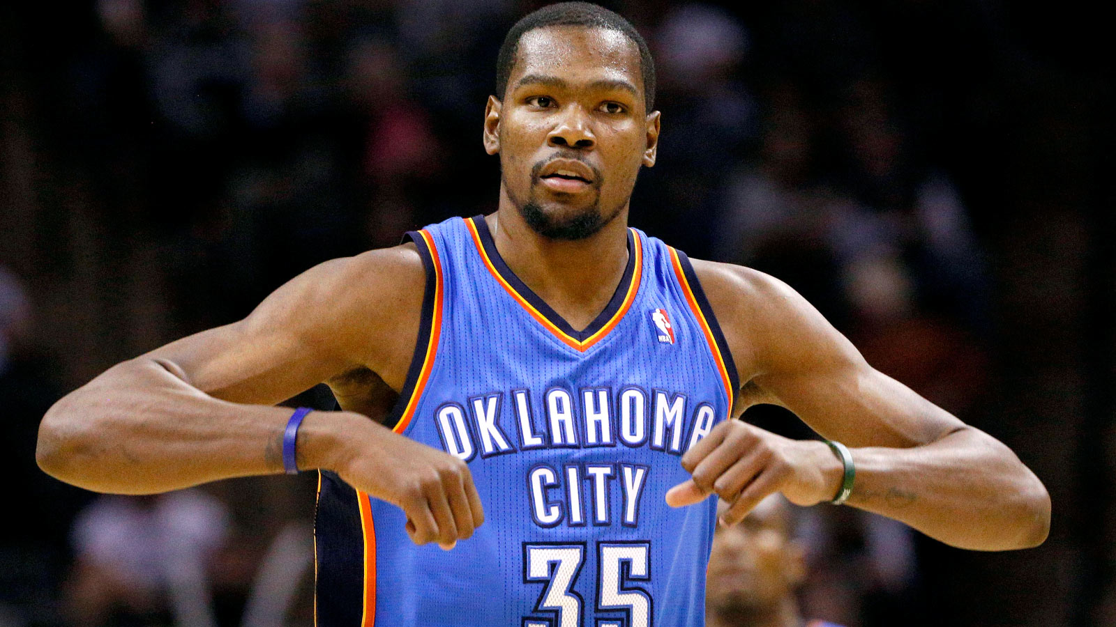 Jan 22, 2014; San Antonio, TX, USA; Oklahoma City Thunder forward Kevin Durant (35) reacts after a shot during the second half against the San Antonio Spurs at AT&T Center. The Thunder won 111-105. Mandatory Credit: Soobum Im-USA TODAY Sports