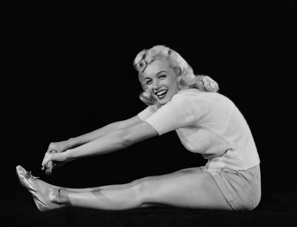 1948:  American film star Marilyn Monroe (1926 - 1962) reaches to touch her toes.  (Photo via John Kobal Foundation/Getty Images)