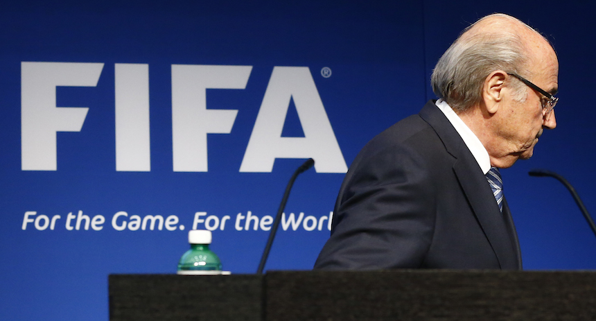 FIFA President Blatter leaves after his statement during a news conference at the FIFA headquarters in Zurich