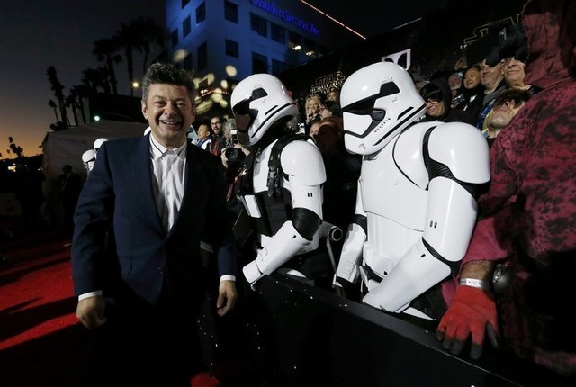 """Actor Andy Serkis (L) walks past fans dressed as """"Storm Troopers"""" as he arrives at the premiere of """"Star Wars: The Force Awakens"""" in Hollywood, California December 14, 2015. REUTERS/Mario Anzuoni"""