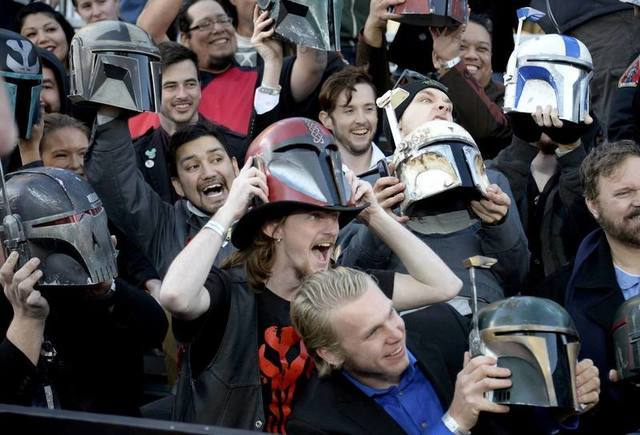 """Fans hold up helmets at the premiere of """"Star Wars: The Force Awakens"""" in Hollywood, California, December 14, 2015. REUTERS/Kevork Djansezian"""