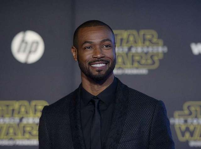 """Actor Isaiah Mustafa arrives at the premiere of """"Star Wars: The Force Awakens"""" in Hollywood, California December 14, 2015. REUTERS/Kevork Djansezian"""