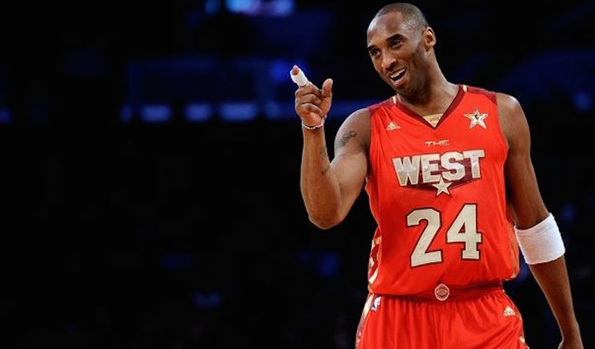 Kobe Bryant smiles and points a finger during the All Star Game 2011