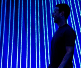 Mark Zuckerberg, chief executive officer of Facebook Inc., watches a presentation during the Facebook F8 Developers Conference in San Francisco, California, U.S., on Wednesday, March 25, 2015. Facebook Inc. is opening up its Messenger chat application, letting developers create software for people to add photos, videos and other enhancements to their online conversations. Photographer: David Paul Morris/Bloomberg via Getty Images