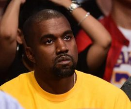 LOS ANGELES, CA - APRIL 13:  Kanye West looks on as he watches as the Los Angeles Lakers take on the Utah Jazz at Staples Center on April 13, 2016 in Los Angeles, California. NOTE TO USER: User expressly acknowledges and agrees that, by downloading and or using this photograph, User is consenting to the terms and conditions of the Getty Images License Agreement.  (Photo by Harry How/Getty Images)