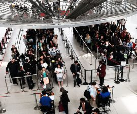NEW YORK, NY - MARCH 24:  People wait in a security line at John F. Kennedy Airport (JFK) on March 24, 2016 in New York City. Following the deadly terrorist attacks in Brussels, airports and train stations around the country have added additional soldiers and police officers in an ongoing effort to deter other potential terrorists.  (Photo by Spencer Platt/Getty Images)