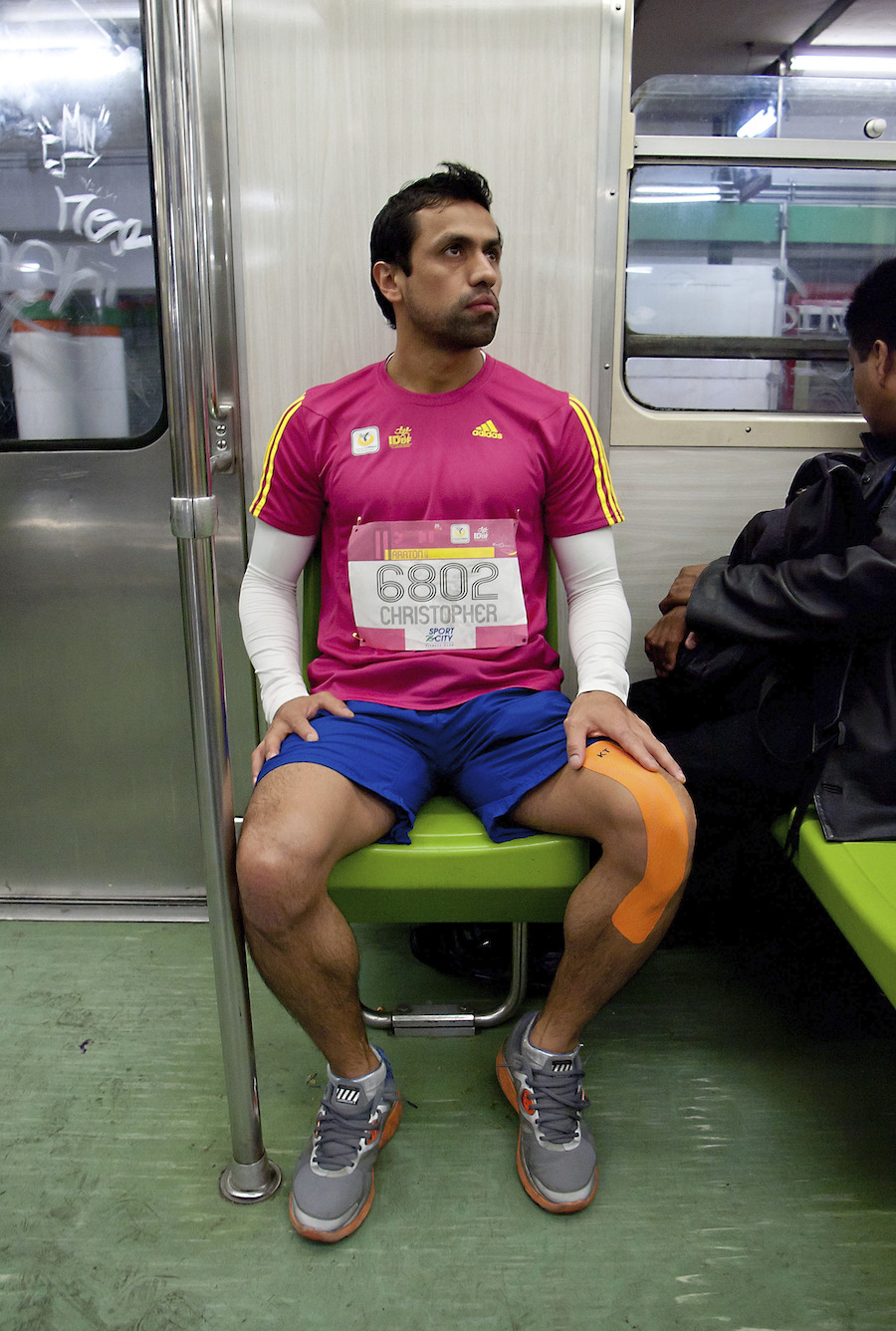 MEXICO CITY, MEXICO - AUGUST 25: An athlete travels by subway prior to the Mexico City International Marathon on August 25, 2013 in Mexico City, Mexico. (Photo by Israel Nu?ez/LatinContent/Getty Images)