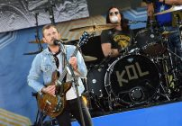 "NEW YORK, NY - JULY 25:  Caleb Followill (L) and Nathan Followill of the band Kings of Leon perform On ABC's ""Good Morning America"" at Rumsey Playfield, Central Park on July 25, 2014 in New York City.  (Photo by Mike Coppola/Getty Images)"