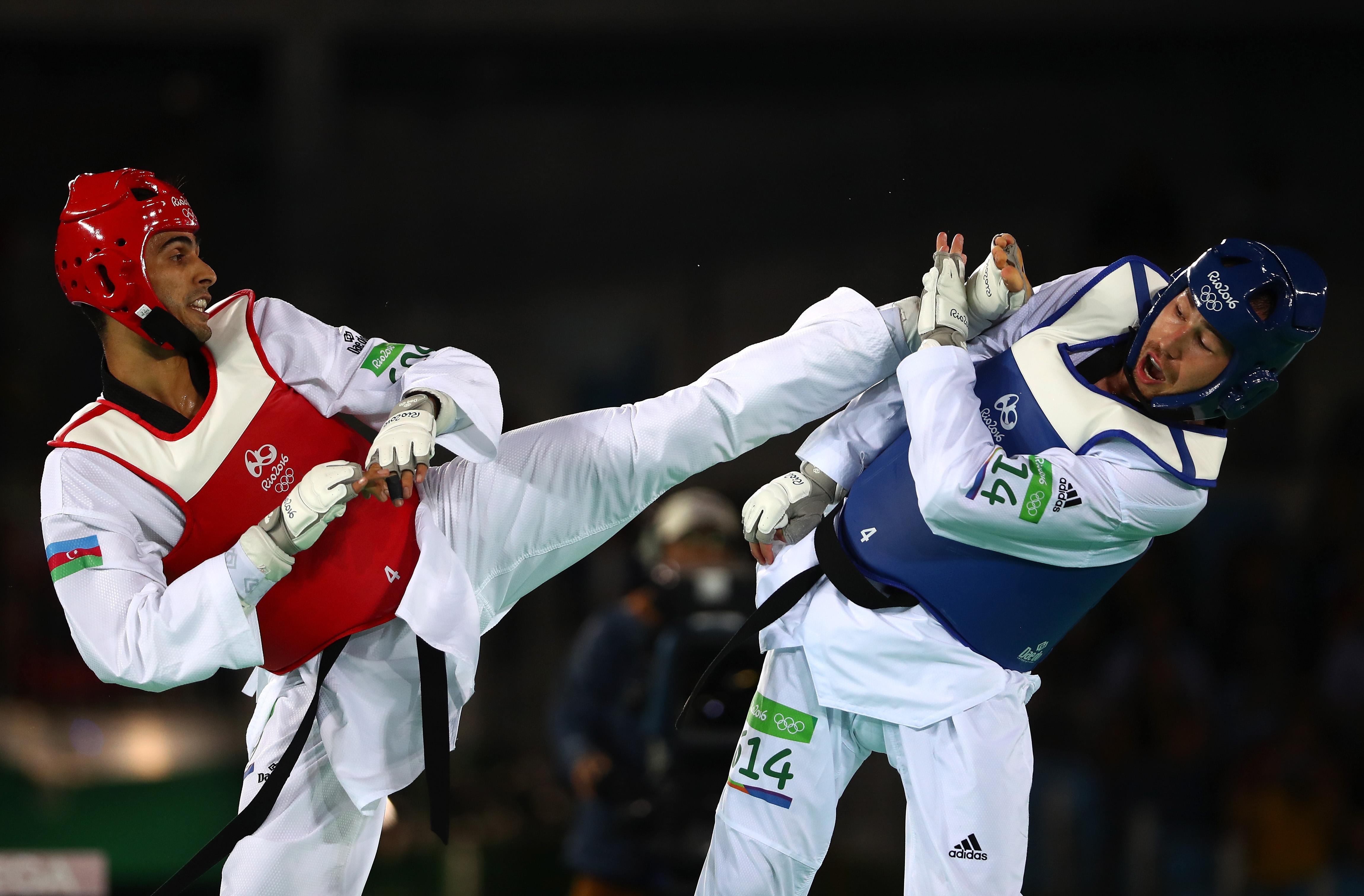 Milad Beigi y Piotr Pazinski durante un combate en los Juegos Olímpicos