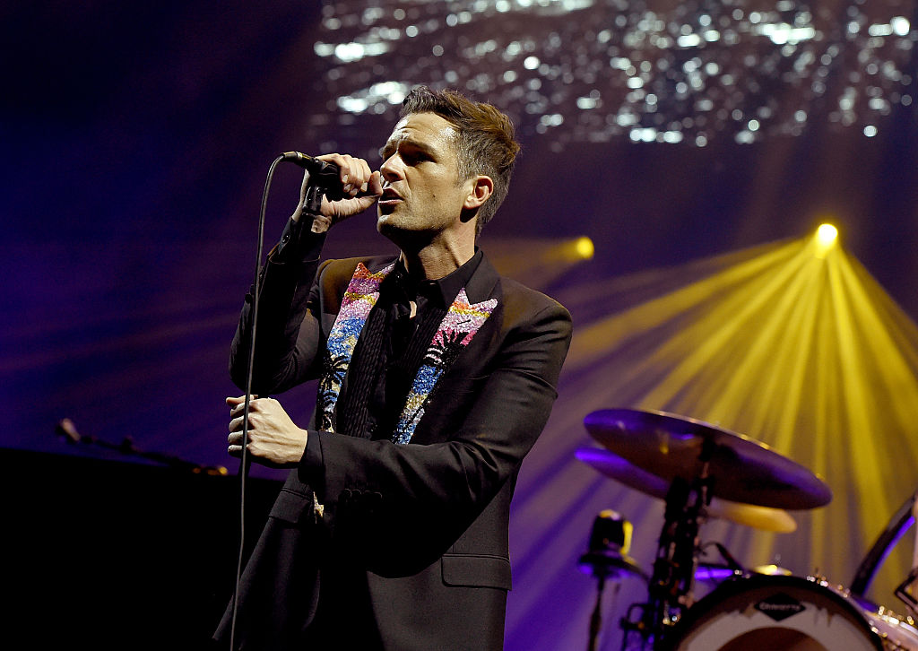 LAS VEGAS, NEVADA - APRIL 06:  Musician Brandon Flowers of The Killers performs onstage during the grand opening of T-Mobile Arena on April 6, 2016 in Las Vegas, Nevada.  (Photo by Kevin Winter/Getty Images for ABA)