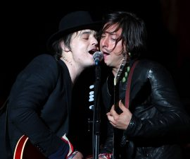 READING, ENGLAND - AUGUST 28: Pete Doherty and Carl Barat of The Libertines performs live on the Main stage during day Two of Reading Festival on August 28, 2010 in Reading, England.  (Photo by Simone Joyner/Getty Images)