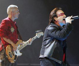 "LAS VEGAS - NOVEMBER 04:  U2 singer Bono (R) and bassist Adam Clayton perform during the first of two sold-out shows of their ""Vertigo"" tour at the MGM Grand Garden Arena November 4, 2005 in Las Vegas, Nevada. The band is touring in support of the album ""How To Dismantle An Atomic Bomb.""  (Photo by Ethan Miller/Getty Images)"