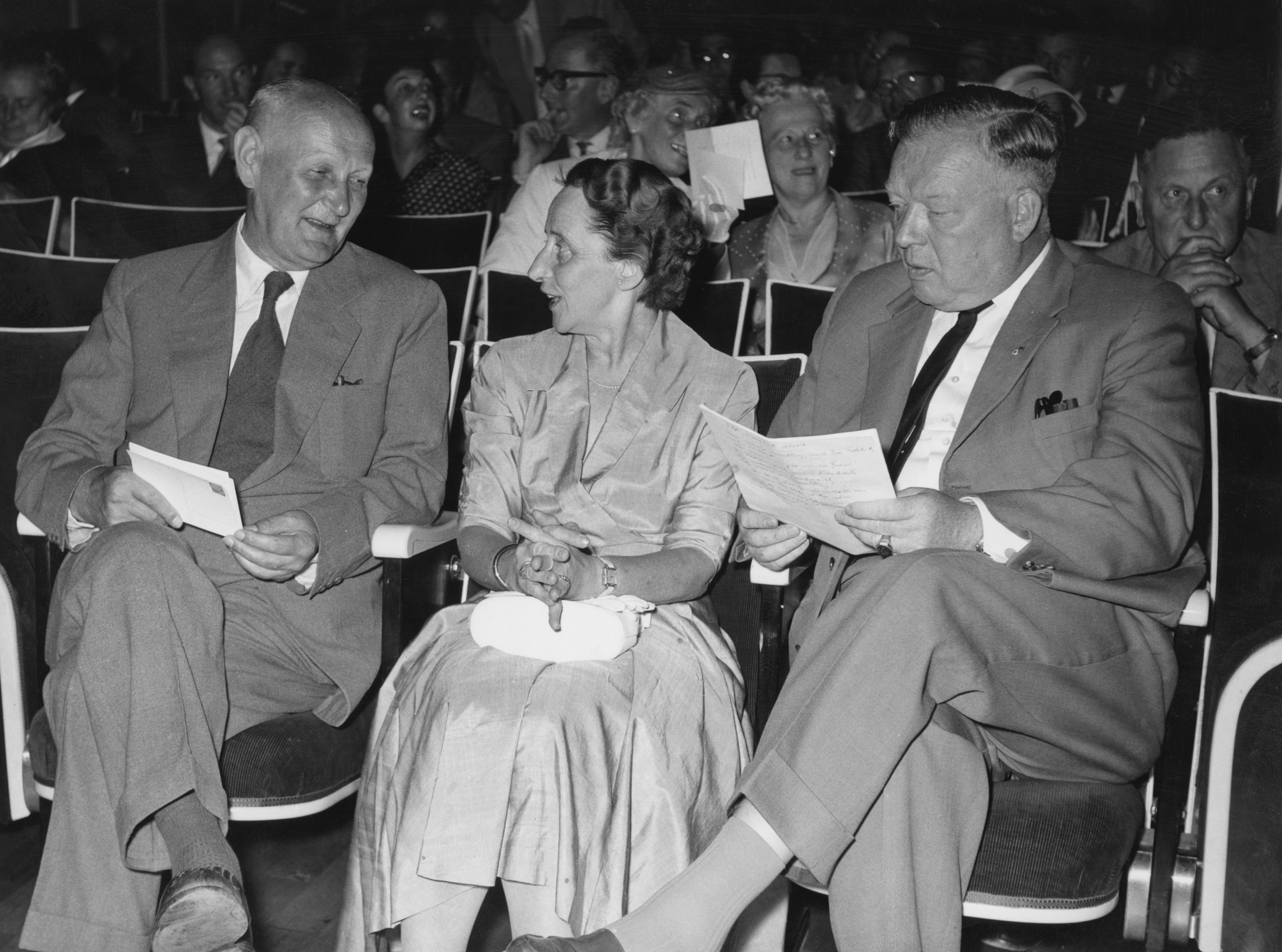 Guests at the 7th meeting of Nobel Prize-winners, Lindau, Germany, 3rd July 1957. On the left is German pathologist Gerhard Domagk (1895 - 1964) and on the right is German doctor Werner Forssmann (1904 - 1979). Behind Forssmann is Swiss chemist Paul Hermann Muller (1899 - 1965). (Photo by Keystone/Hulton Archive/Getty Images)