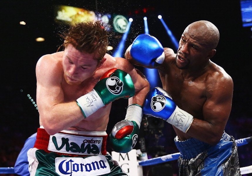 LAS VEGAS, NV - SEPTEMBER 14: (L-R) Floyd Mayweather Jr. throws a right to Canelo Alvarez during their WBC/WBA 154-pound title fight at the MGM Grand Garden Arena on September 14, 2013 in Las Vegas, Nevada. (Photo by Al Bello/Getty Images)