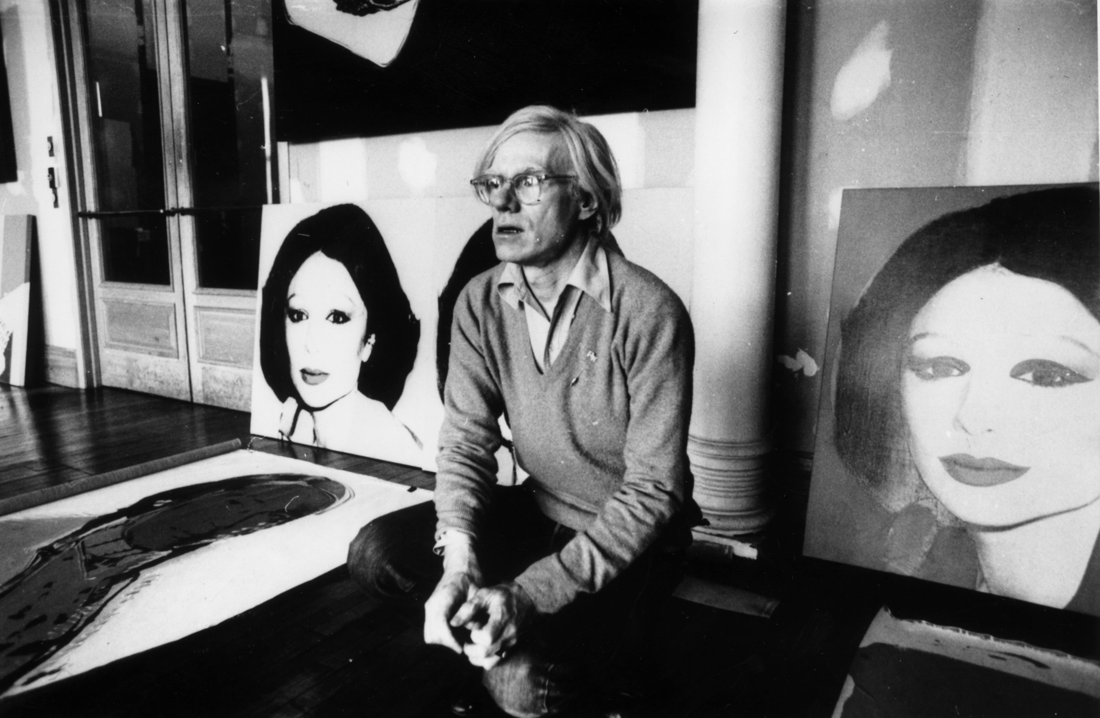 Artist Andy Warhol (1928 - 1987) in New York with his latest work, 'Princess Of Iran'. (Photo by Graham Wood/Getty Images)