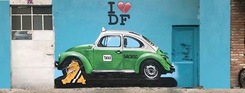 Grafiti de taxi viejito con una araña puesta